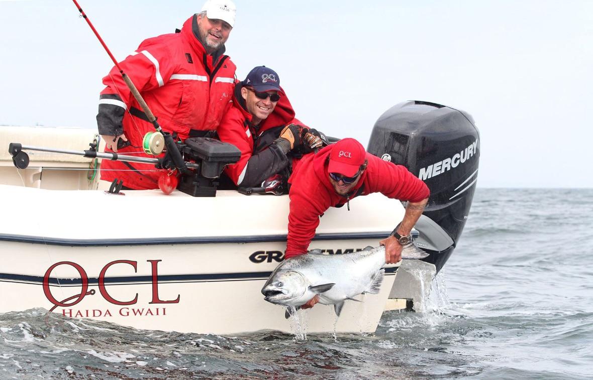 British Columbia Salmon Fishing Trips man catching & releasing fish