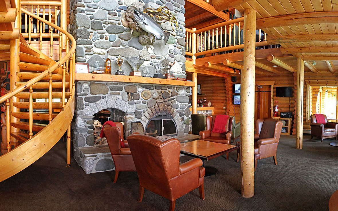 QCL luxury fishing resorts main lodge's grand fireplace
